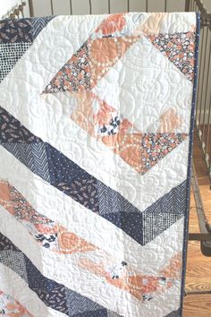 Ready-to-Ship triangle quilt in navy and peach from Miss Polly's Piece Goods