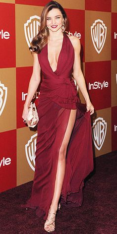 Miranda Kerr may not have made it to the actual Golden Globe Awards, but the supermodel did look undeniably gorgeous at the Warner Bros and InStyle After Party later that evening. She donned a rich burgundy Zuhair Murad gown with a plunging neckline and thigh high slit. Her accessories included a nude Salvatore Ferragamo clutch and strappy sandals paired with H. Stern jewelry. Matching burgundy nails and crimson lips added the finishing touches.