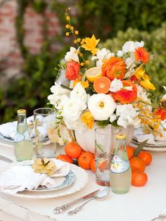 Orange segments, golden blooms and lemonade – perfect summer table