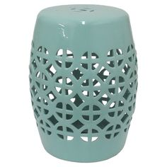 Perfect for resting a tray of cocktails or offering guests a seat at your next soiree, this ceramic garden stool showcases a cutout linked circles design.