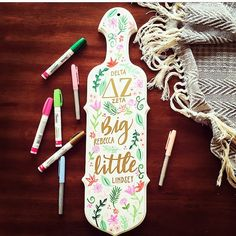 I like the white paint with the flowers and gold letters (stickers for letters would be cute too) Sorority Canvas, Sorority Paddles, Sorority Crafts, Sorority Recruitment, Big Little Basket, Big Little Gifts, Gamma Phi Beta, Kappa Delta, Alpha Chi