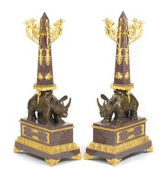 A pair of French gilt and patinated bronze mounted marble four light candelabra