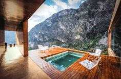 hot tub outside & view of mountain