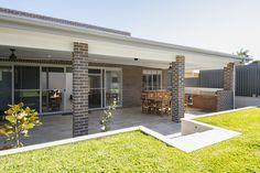 Open plan #facebrick #alfresco entertaining area with outdoor kitchen and sliding stacker doors. #hallharthomes #alfrescoinspiration  image058