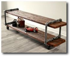 Make-your-own-Vintage-Industrial-Cast-Iron-Pipe-Table-TV-Stand-with-plumbing-parts-and-old-wood.jpg