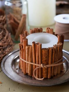 The winter craft to beat all winter crafts: Dress up a candle with cinnamon sticks. #candles #diy #crafts
