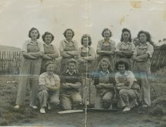 There was sometimes time for relaxation on the farm for the Land Army girls.  Here, the girls are taking a break during a cricket game.