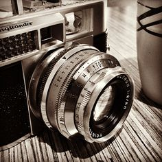 Voigtlander's Day Out [Explored]  Coffee with my camera.  Vitomatic IIa with an Ultron 1:2 50mm Lens