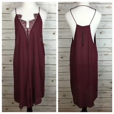 "[Free People] Parisian Night Slip Dress Boho Gypsy Eyelash lace traces the v-neck of a racerback keyhole slip dress. Spaghetti straps. Small front slit. Lightweight and breezy. Perfect for layering! Color is a burgundy called ""Pansy Purple"".   Fabric: 100% Rayon  Bust: XS: 18"" S: 19"" M: 20"" L: 21"" Length: 38"" Condition: NWT!   No Trades! Free People Dresses"