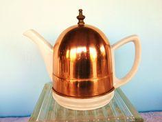 Vintage Teapot White Ceramic with Copper Cozy. $26.00, via Etsy.