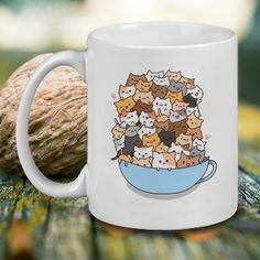 http://thepodomoro.com/collections/coffee-mugs-and-tea-cups/products/cats-in-a-cup-mug-tea-mug-coffee-mug