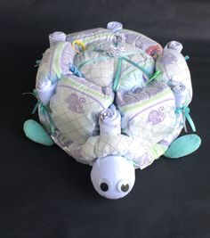 This Turtle diaper cake is PERFECT for the diaper centerpiece at your next baby shower! This unique diaper cake comes with *50 size 1 Luvs * 8 washclothes * 2 pairs infant socks   You have a couple options for color pallets and sizes. Please message me so we can create a perfectly unique baby gift for a special mommy to be in your life!   ***Each turtle is uniquely made. Some variations may need to be made based on product availability.***