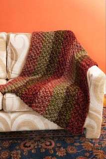 Brighten up your decor with this striped moss stitch afghan. (Lion Brand Yarn)