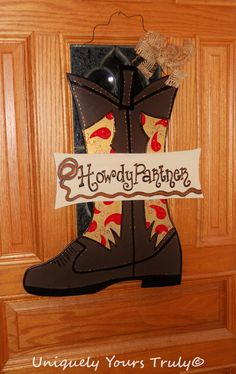 Check out this item in my Etsy shop https://www.etsy.com/listing/181521582/cowboy-boot-wood-door-hanger