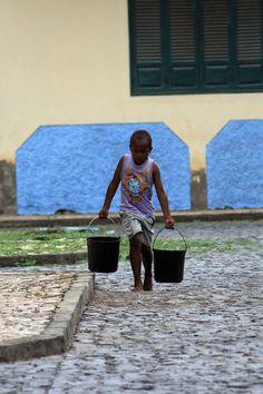 A Kid Carries Water by sergiomartins.deviantart.com