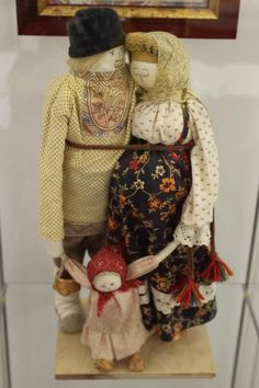 Russian old doll, sweet family with expectant mother?