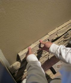 how to install faux stone on a inside wall, concrete masonry, diy, how to, wall decor, Start from the bottom and work your way up to the ceiling This will ensure that the seams on the next row will line up