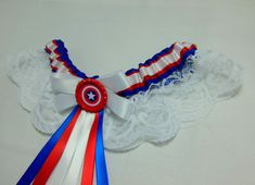 Royal Blue, Red and White satin with White Lace Skirt. White, Red & Royal Blue Ribbon Bow and matching Hanging Ribbons and Red Crown/ Glass Top with Captain America Logo inside. Lace Garter, Garter Set, White Wedding Garter, Wedding Garters, Blue Ribbon, Ribbon Bows, Wedding Looks, Perfect Wedding, Captain America Logo