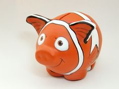 I bought a couple of clay piggy banks at a local pottery shop and started to paint an unusual piggy bank collection. a Nemo piggy b. Girls Pad, Pig Bank, Sea Nursery, Personalized Piggy Bank, Toddler Themes, Paint Your Own Pottery, This Little Piggy, Do It Yourself Crafts, Pottery Painting