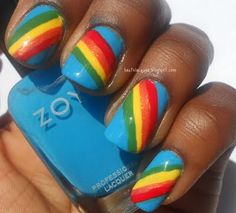 Great rainbow manicure, I'd prefer on white , rainbow only on ring finger with crystals at the bottom