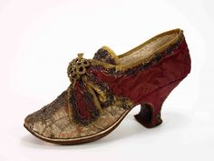 Single women's shoe, c. 1780. Dark red silk damask and floral silk brocade, high curved heel, pointed toe.