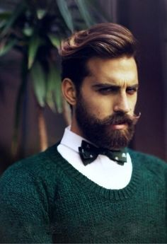 It's the woolen jumper over a top buttoned white shirt I like. The dickybow helps not make the buttoned collar so stark.