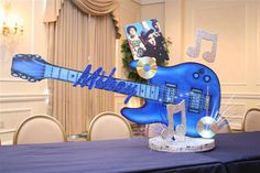 Music Bar & Bat Mitzvah Party Theme Ideas - Guitar Centerpieces by Life O' The Party - mazelmoments.com