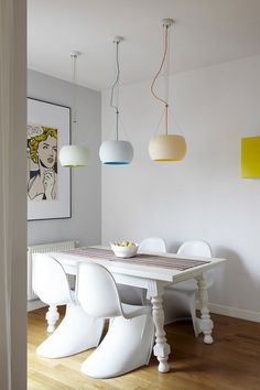 Interior Design Magazine: Verner Panton chairs and glass pendant fixtures combine with a refinished vintage table in the dining area at this Warsaw apartment designed by Widawscy Studio Architektury. Interior Design Magazine, Apartment Interior Design, Modern Interior Design, Color Interior, Lovely Apartments, Panton Chair, Appartement Design, Beautiful Dining Rooms, Interiores Design