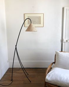 A Catchy Black Metal Floor Lamp With A Tiny Wicker Lampshade For A Natural And Coastal Feel In The SpaceThe post A Catchy Black Metal Floor Lamp With A Tiny Wicker Lampshade For A Natural And Coastal Feel In The Space appeared first on Dobry Prawnik. Hudson Homes, Metal Floor, Black Floor Lamp, Interior Lighting, Interior Styling, Lighting Design, Vintage Lamps, Black Metal, Rattan