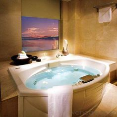 Would love to have a soaking tub with a getaway picture to look at.