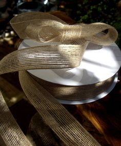 "Natural Jute Ribbon 1"" width 25 yards $7.49 each  -  The spool measures 5.75"" wide x 1.25"" tall"