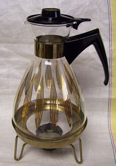 RESERVED for DIANA HOKEVintage UNUSED Atomic Pyrex Gold Black Glass Coffee Pot Carafe with Warmer Stand 8 Cup on Etsy, Sold