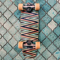 Zig Zag skateboard against turquoise tiles