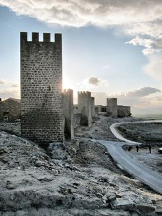 Castle in Narvanna Spain, with the sun rising and the snow fresh on the ground.