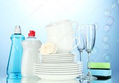 Empty clean plates, glasses and cups with dishwashing liquid and sponges on blue background Label Design, Packaging Design, Clean Plates, Dishwashing Liquid, Islamic Art Calligraphy, Cosmetic Packaging, Deep Cleaning, Blue Backgrounds, Dishwasher