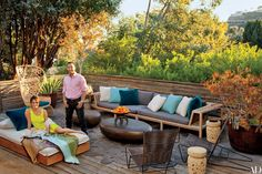 At their Don Stewart–designed Los Angeles home, Chrissy Teigen and John Legend sit on a terrace outfitted with a Rodolfo Dordoni sofa and a James Perse daybed with cushions and pillows covered in Sunbrella fabrics.
