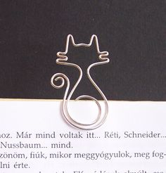 So cute    Mirr-Murr - cat wire bookmark. $6.50, via Etsy.