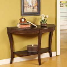 Beautify your home with this half round wood console table. With a rich walnut finish and curved legs, this table will add a touch of sophistication to any room. A convenient shelf holds home decor, making this table as practical as it is elegant.