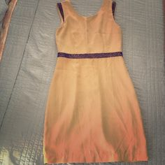 "Very Sexy Evening Dress Got a hot date? This is your dress. This is definitely a show stopper. It's low cut in the back and hits right at the mid thigh (I'm 5'9"".) it's classy and gorgeous on just about anyone!! There is one bead that has come loose in the back on the right side, but that's a easy fix! It's otherwise in excellent condition. Dresses Mini"