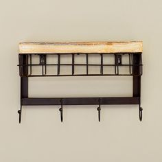 Found it at AllModern - Modern 4 Hook Wall Rack with Basket