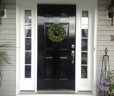 Grey house with black front door || Chinoiserie Chic: The Chinoiserie Front Door - Glossy Black.