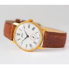 Gold plated men's wristwatch ZIM, Roman numerals men's watch,... (9.900 RUB) ❤ liked on Polyvore featuring men's fashion, men's jewelry, men's watches, retro mens watches, mens dress watches, mens watches, mens dress watch and mens leather band watches