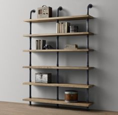RH baby&child's Industrial Pipe Wide Shelving:Sturdy steel pipes and matching cast fittings serve as the structure for our hardworking pieces, while warm wood planks provide support for books and a workspace for the industrious.