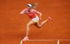 Mutua Madrid Open - Day Two - Maria Sharapova of Russia stretches to play a forehand against Timea Bacsinszky of Switzerland in their second round match during day one of the Mutua Madrid Open tennis tournament at the Caja Magica on May 3, 2015 in Madrid, Spain.