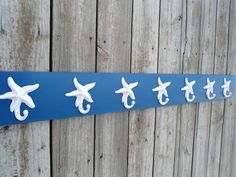 starfish hooks, extra long towel rack, beach towel storage, pool towels, outdoor shower, 7 hooks,. $60.00, via Etsy.