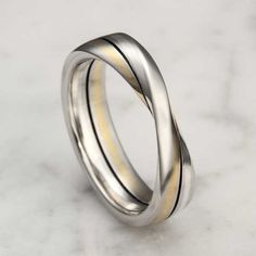 Mobius Strip Wedding Band.This contemporary wedding band takes the shape of a Mobius strip. Choose any two colors for the inlay stripes.