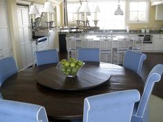 """Beautiful Kitchen Dining table, in amazing coastal home. 72"""" round farmhouse table in antique walnut finish, with matching lazy susuan"""