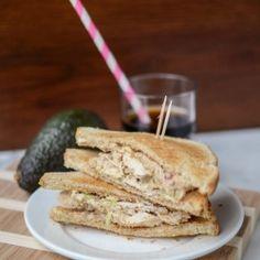 A chicken salad sandwich filled with avocado and greek yogurt - no mayo!