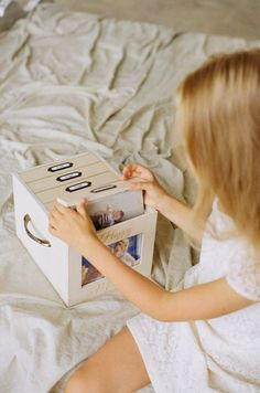 Golden and ivory wooden photo box with 6 photo albums and front photo frame by…