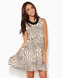 Shop online for fashion apparel like this flowy dress that has a unique branch-like design and a cinched waist offering ultimate flattery.